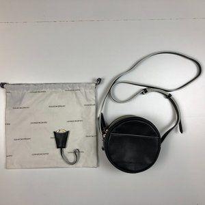 Isaac Mizrahi Nolita black circle crossbody bag